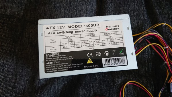 Photo of a PC power supply, showing the rated current and voltage table