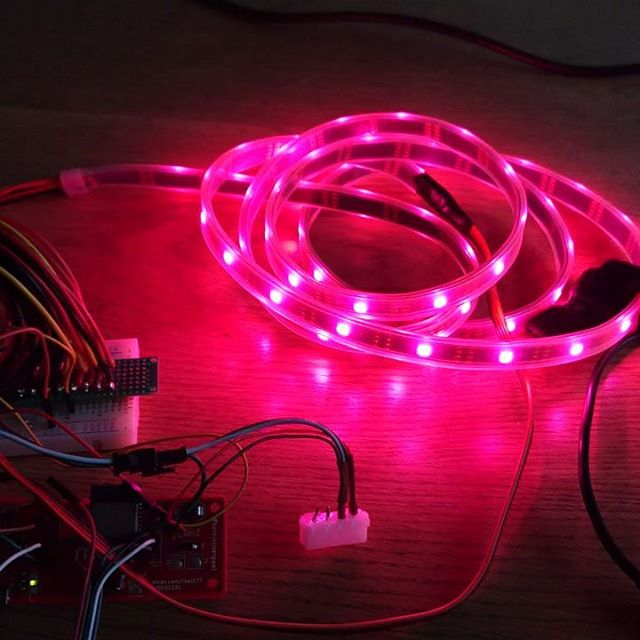 A strip of RGB LEDs lit up pink